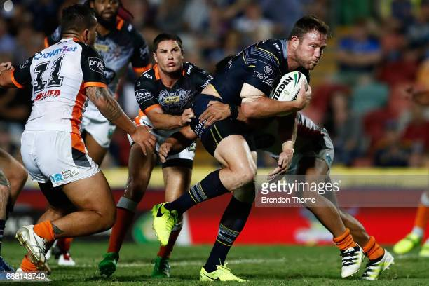 Scott Bolton of the Cowboys runs the ball during the round six NRL match between the North Queensland Cowboys and the Wests Tigers at 1300SMILES...