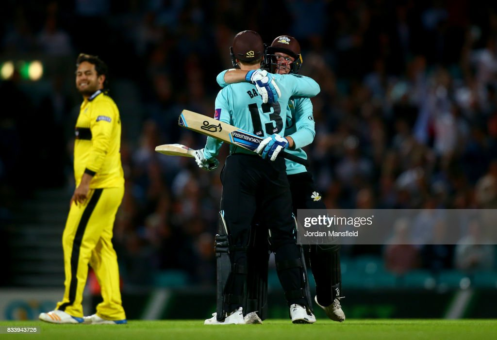 Scott Borthwick and Gareth Batty of Surrey celebrate their victory during the NatWest T20 Blast match between Surrey and Gloucestershire at The Kia Oval on August 17, 2017 in London, England.