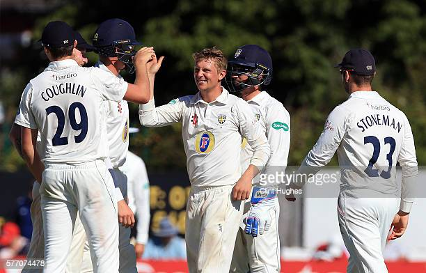 Scott Borthwick of Durham celebrates after he takes the wicket of Lancashire's Kyle Jarvis during day three of the Specsavers County Championship...