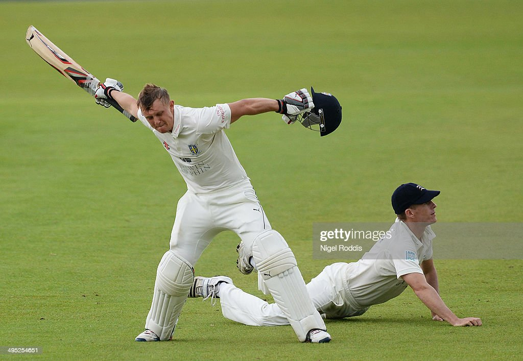 Scott Borthwick of Durham (L) celebrates scoring a double century during The LV County Championship match between Durham and Middlesex at The Riverside on June 2, 2014 in Chester-le-Street, England.