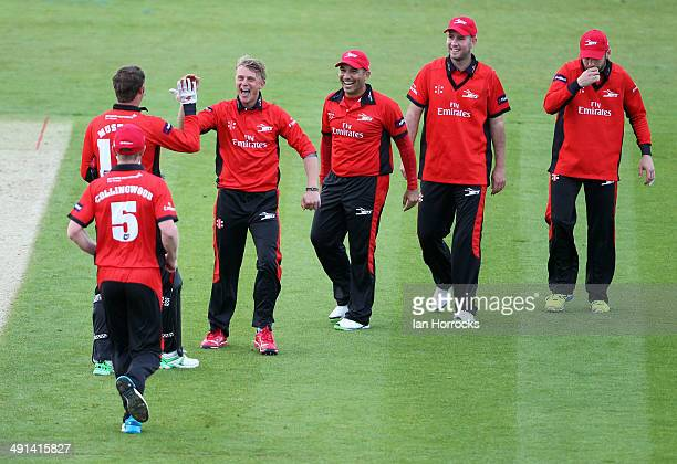 Scott Borthwick of Durham Jets celebrates the run out of Tom KohlerCadmore with teammates during the Natwest T20 Blast match between Durham Jets and...