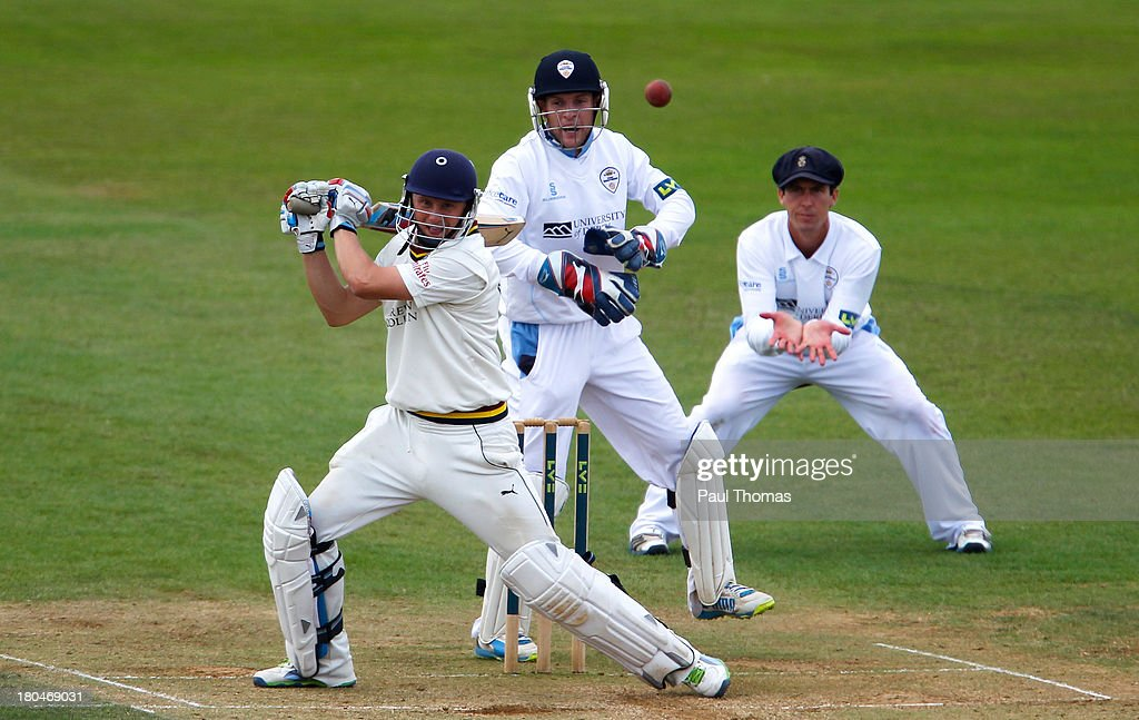 Scott Borthwick (L) of Durham plays a shot during the LV County Championship match between Derbyshire and Durham at The County Ground on September 13, 2013 in Derby, England.