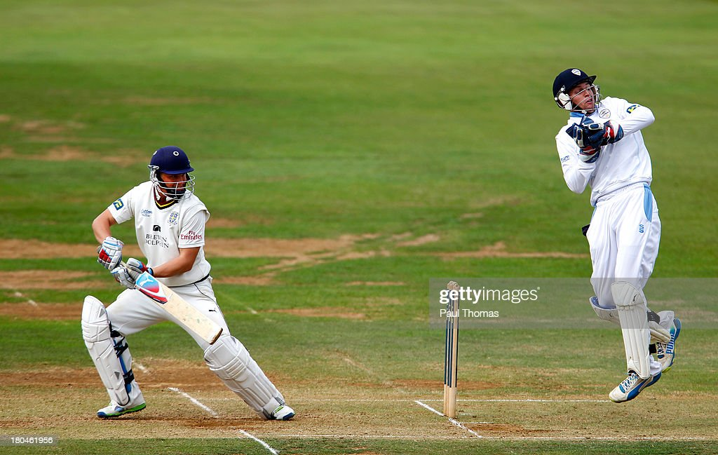 Scott Borthwick (L) of Durham plays a shot past Derbyshire's Tom Poynton during the LV County Championship match between Derbyshire and Durham at The County Ground on September 13, 2013 in Derby, England.