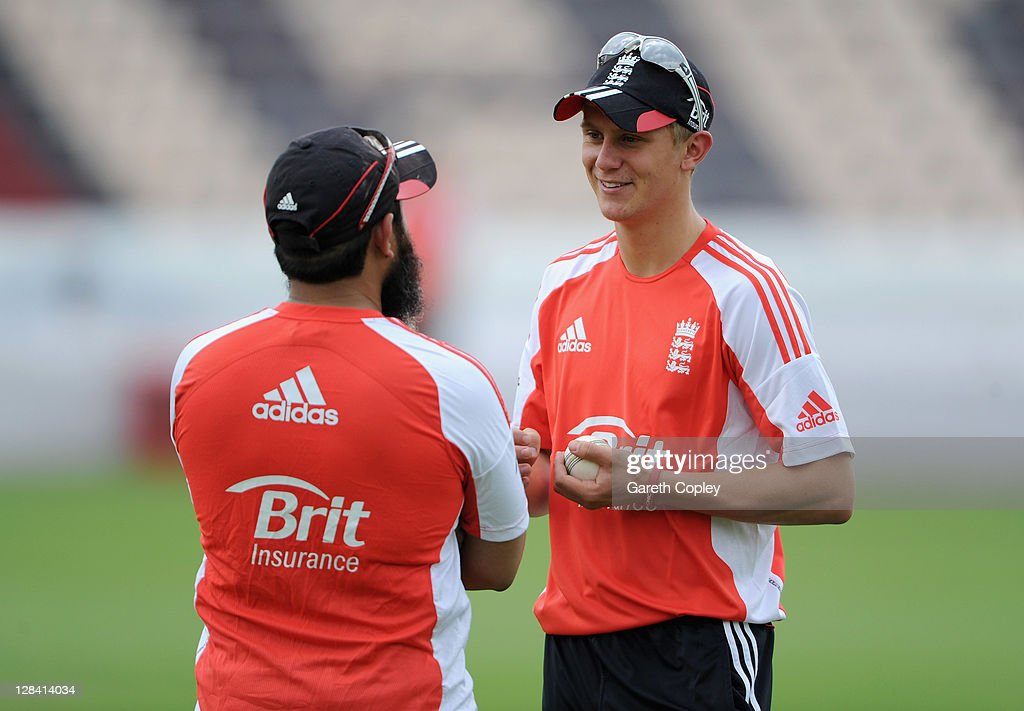 Scott Borthwick of England speaks with spin bowling coach Mushtaq Ahmed during a nets session at The Rajiv Gandhi International Cricket Stadium on...