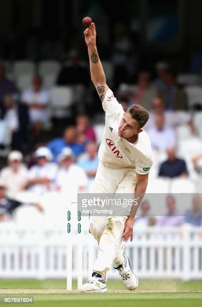 Scott Borthwick of Surrey bowles during day two of the Specsavers County Championship Division One match between Surrey and Hampshire at The Kia Oval...