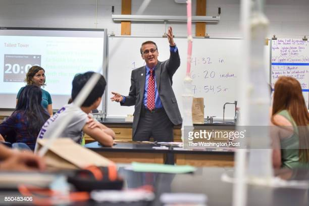 Scott Brabrand chats with students in the biology class of Ms Allison Prell during the first day of school at Chantilly High School on Monday August...