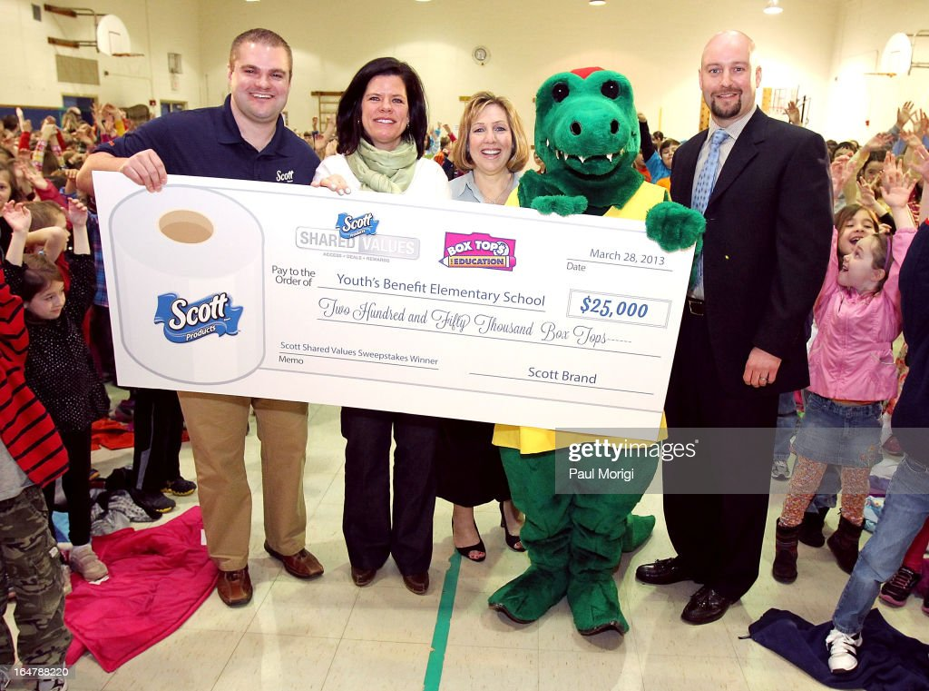 Scott Brand Manager Ben Johnson presents a $25,000 check to Box Tops Coordinator Jenn Stump, PTA President Laura Runyeon, Mascot Al E. Gator and Principal Thomas Smith at a school assembly to celebrate the Scott Shared Values Sweepstakes award to Youth's Benefit Elementary School on March 28, 2013 in Fallston, Maryland.