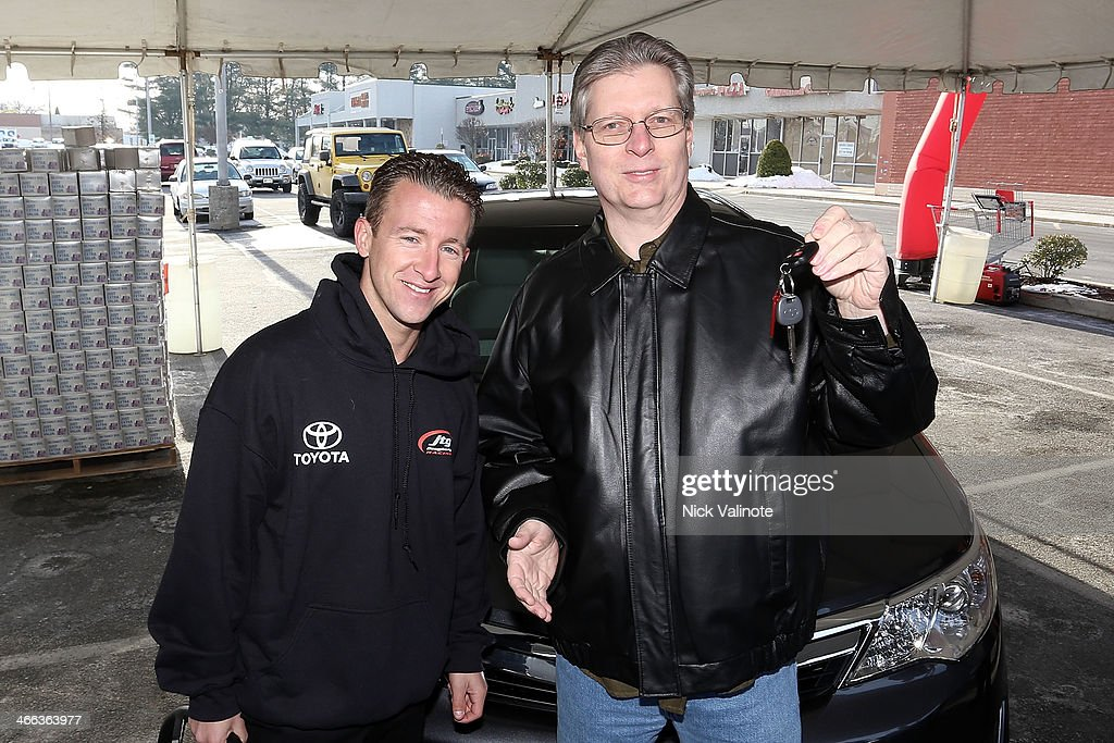 Scott Brand Win My Car sweepstakes winner Robert 'Bob'Wilson, Jr. receives the keys to his brand new 2014 Toyota Camry from car #47 NASCAR driver AJ Allmendinger on February 1, 2014 in Hammonton, New Jersey.