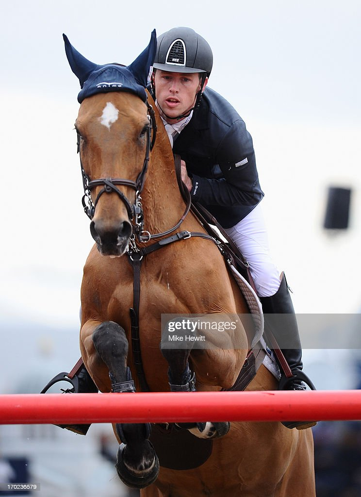 <a gi-track='captionPersonalityLinkClicked' href=/galleries/search?phrase=Scott+Brash&family=editorial&specificpeople=7104508 ng-click='$event.stopPropagation()'>Scott Brash</a> of Great Britain on Ursula XII in action during the Longines Global Champions Tour of London on Day Four at Olympic Park on June 9, 2013 in London, England.