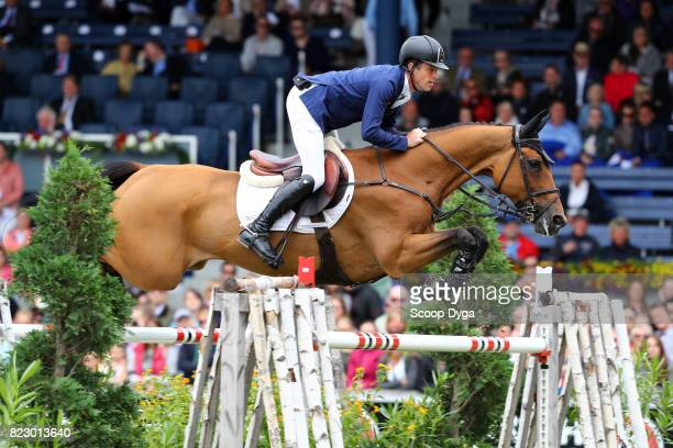Scott BRASH riding URSULA XII during the Rolex Grand Prix part of the Rolex Grand Slam of Show Jumping of the World Equestrian Festival on July 23...
