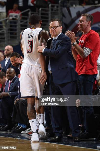 Scott Brooks and Bradley Beal of the Washington Wizards hug in Game Four of the Eastern Conference Semifinals against the Boston Celtics during the...