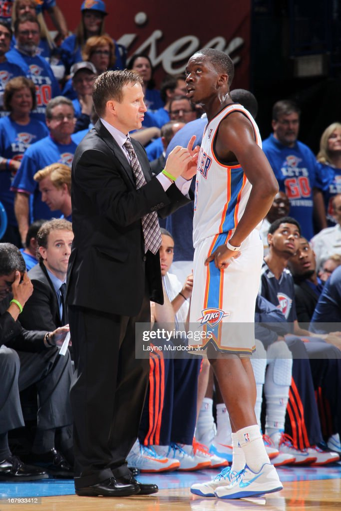 Scott Brooks and Reggie Jackson #15 of the Oklahoma City Thunder talk during the game against the Houston Rockets in Game Five of the Western Conference Quarterfinals during the 2013 NBA Playoffs on May 1, 2013 at the Chesapeake Energy Arena in Oklahoma City, Oklahoma.
