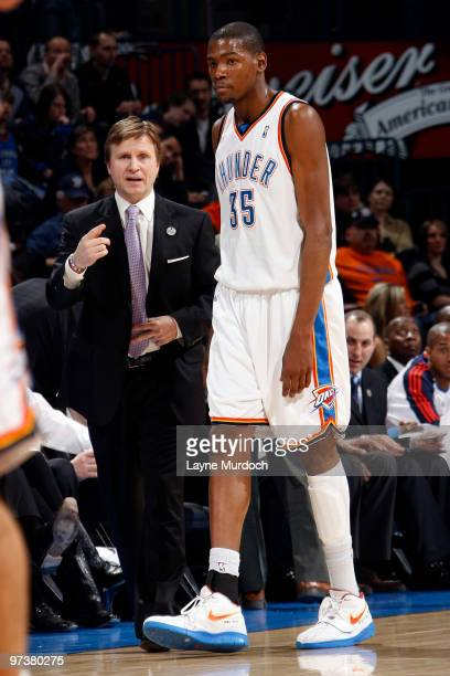 Scott Brooks Head Coach of the Oklahoma City Thunder speaks with Kevin Durant during the game against the Sacramento Kings on March 2 2010 at the...