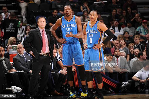 Scott Brooks Kevin Durant and Russell Westbrook of the Oklahoma City Thunder talk during the game against the San Antonio Spurs on December 21 2013...