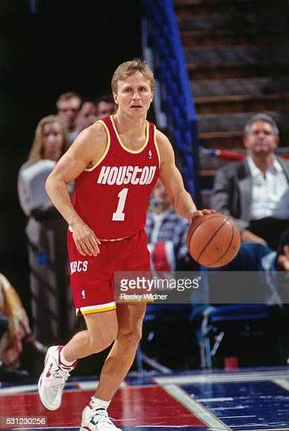 Scott Brooks of the Houston Rockets dribbles the ball up court during a game against the Sacramento Kings circa 1994 at the ARCO Arena in Sacramento...