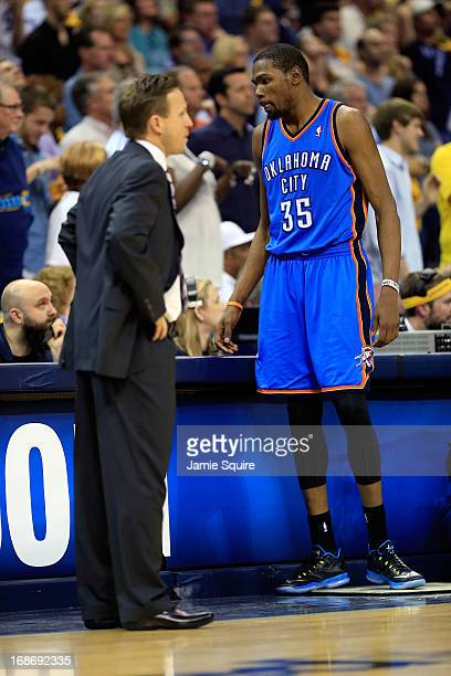 Scott Brooks of the Oklahoma City Thunder talks with Kevin Durant during Game Four of the Western Conference Semifinals of the 2013 NBA Playoffs...
