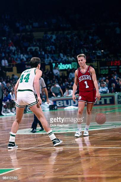 Scott Brooks of the Philadelphia 76ers moves the ball up court against Danny Ainge of the Boston Celtics during a game played in 1989 at the Boston...