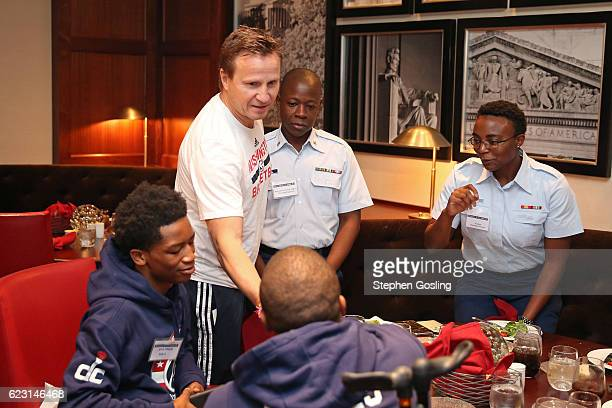 Scott Brooks of the Washington Wizards and members of TAPS and military families share lunch and practice together at Verizon Center in Washington DC...