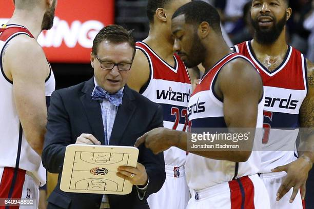 Scott Brooks of the Washington Wizards talsk to John Wall during the second half of a game against the New Orleans Pelicans at the Smoothie King...