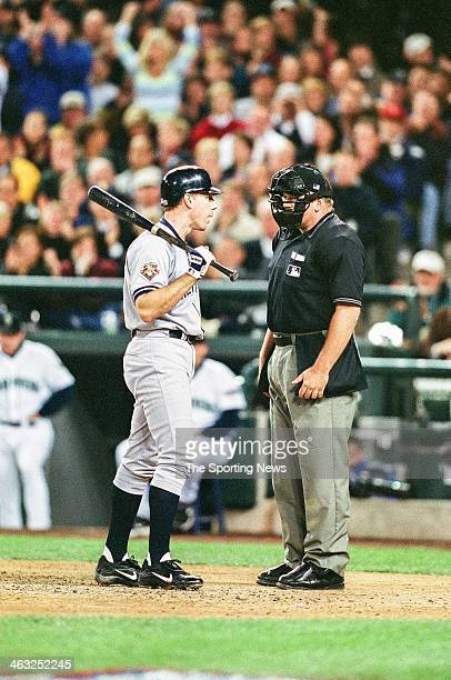 Scott Brosius of the New York Yankees talks with umpire Wally Bell during Game Two of the American League Championship Series against the Seattle...