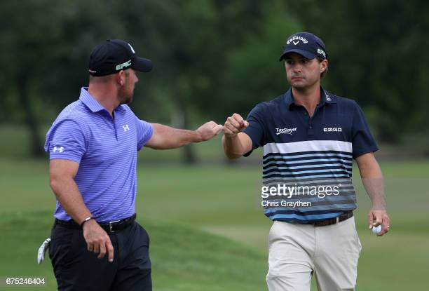 Scott Brown and Kevin Kisner react to their putt during the final round of the Zurich Classic at TPC Louisiana on April 30 2017 in Avondale Louisiana