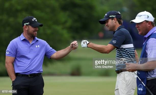 Scott Brown and Kevin Kisner react to their putt on the fifth hole during the final round of the Zurich Classic at TPC Louisiana on April 30 2017 in...
