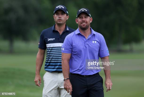 Scott Brown and Kevin Kisner walk down the fairway during the final round of the Zurich Classic at TPC Louisiana on April 30 2017 in Avondale...