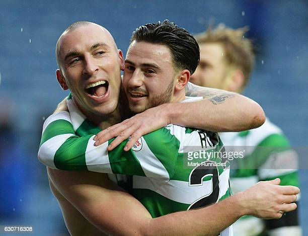 Scott Brown and Patrick Roberts of Celtic celebrate their 21 win after the Ladbrokes Scottish Premiership match between Rangers and Celtic at Ibrox...