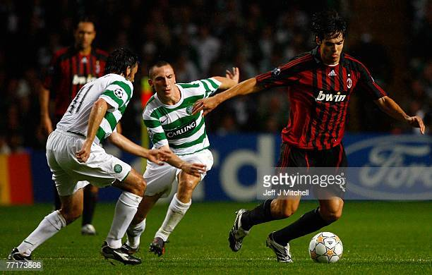 Scott Brown and Paul Hartley of Celtic tackle Kaka of AC Milan during the UEFA Champions League match between Celtic and AC Milan at Celtic Park...