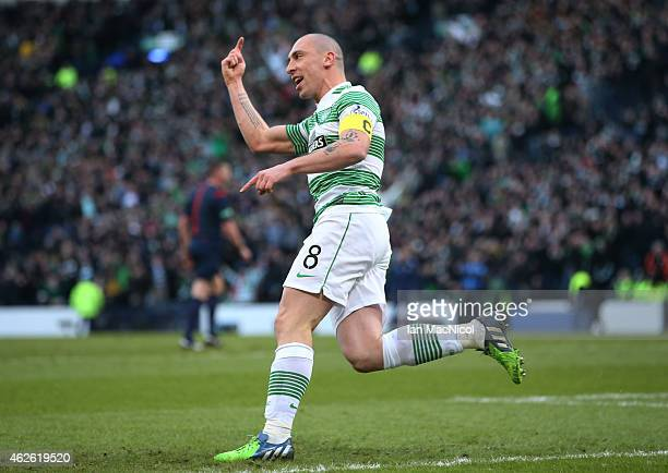 Scott Brown celebrates after Celtic's Scottish forward Leigh Griffiths scores during the Scottish League Cup SemiFinal football match between Celtic...