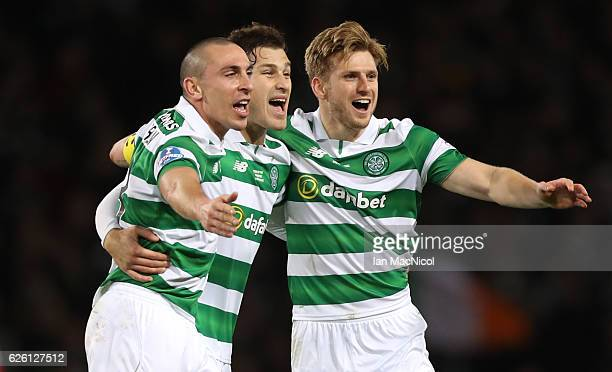 Scott Brown Erik Sviatchenko and Stuart Armstrong of Celtic celebrate during the Betfred Cup Final between Aberdeen and Celtic at Hampden Park on...