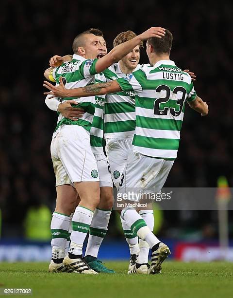 Scott Brown Erik Sviatchenko Stuart Armstrong and Mikael Lustig of Celtic celebrate during the Betfred Cup Final between Aberdeen and Celtic at...