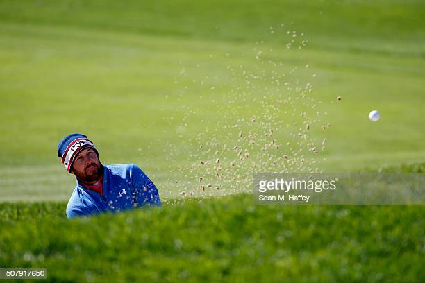 Scott Brown hits a shot on the 17th hole during the final round of the Farmers Insurance Open at Torrey Pines South on February 1 2016 in San Diego...