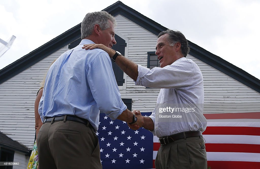 Scott Brown, left, shakes hands with Mitt Romney, right, after Romney endorsed him at Bittersweet Farm in Stratham, New Hampshire July 2, 2014.