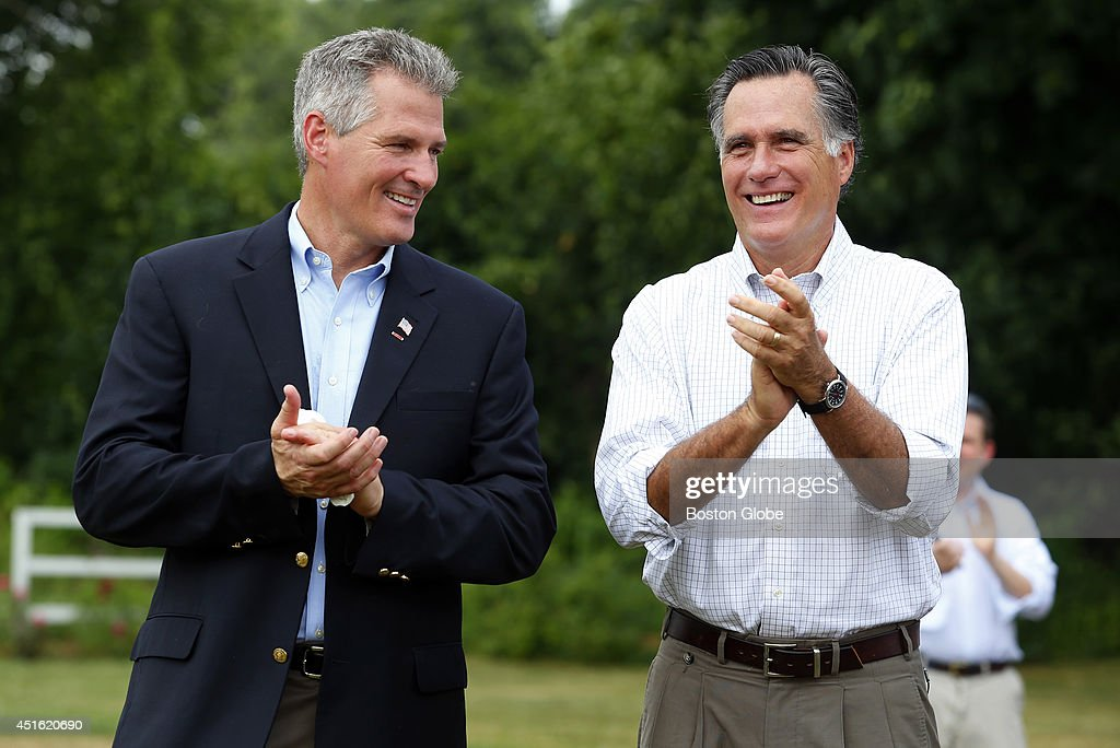 Scott Brown, left, stands with Mitt Romney before Romney endorsed him at Bittersweet Farm in Stratham, New Hampshire July 2, 2014.