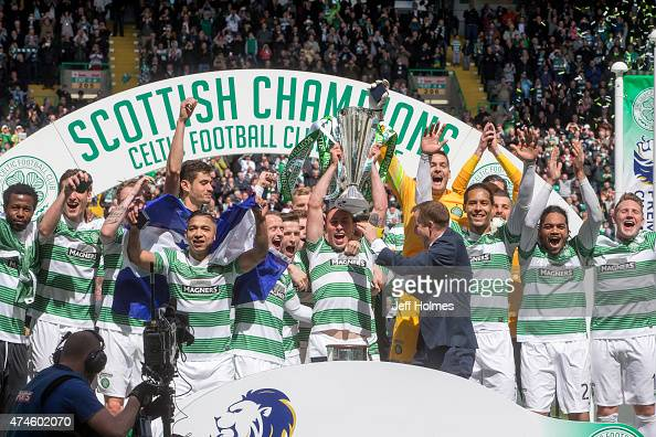 Scott Brown lifts the cup for Celtic after the Scottish Premiership Match between Celtic and Inverness Caley Thistle at Celtic Park on May 24 2015 in...
