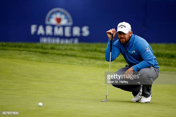 Scott Brown lines up a putt on the 15th green during Round 3 of the Farmers Insurance Open at Torrey Pines South on January 30 2016 in San Diego...