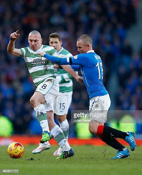 Scott Brown of Celtic and Kenny Miller of Rangers battle for the ball during the Scottish League Cup SemiFinal between Celtic and Rangers at Hampden...