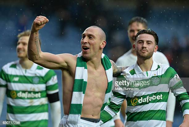 Scott Brown of Celtic celebrate at the final Whistle with team mate Patrick Roberts during the Scottish Premiership match between Rangers FC and...