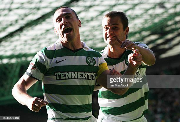 Scott Brown of Celtic celebrates his goal with teammate Shaun Maloney during the Clydesdale Bank Scottish Premier League match between Celtic and...