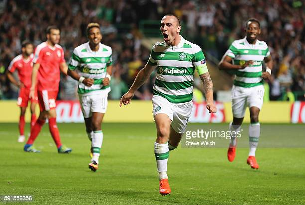 Scott Brown of Celtic celebrates scoring his team's fifth goal during the UEFA Champions League Playoff First leg match between Celtic and Hapoel...