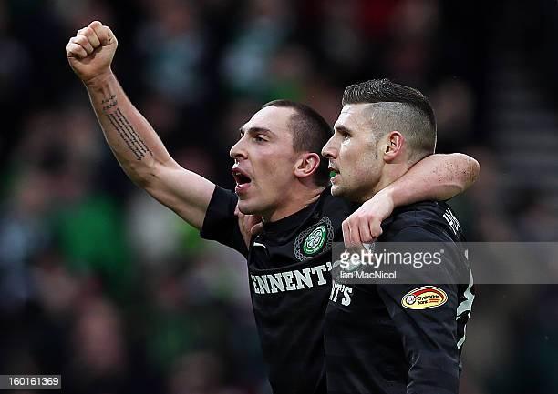 Scott Brown of Celtic congratulates goal scorer Gary Hooper during the St Mirren and Celtic Scottish Communities League Cup Semi Final match at...
