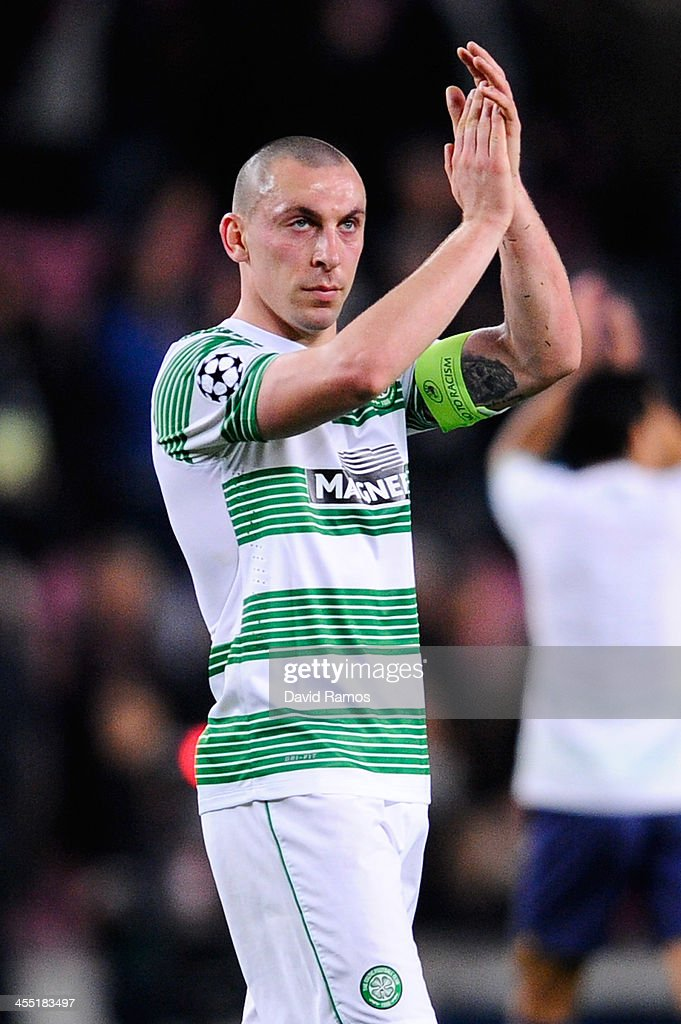 Scott Brown of Celtic FC acknowledges Celtic FC supporters at the end of the Champions League Group H match between FC Barcelona and Celtic FC at Camp Nou on December 11, 2013 in Barcelona, Spain.