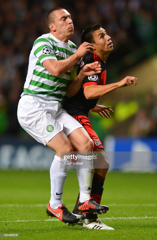 Scott Brown of Celtic FC and <a gi-track='captionPersonalityLinkClicked' href=/galleries/search?phrase=Nicolas+Gaitan&family=editorial&specificpeople=5538639 ng-click='$event.stopPropagation()'>Nicolas Gaitan</a> of SL Benfica collide during the UEFA Champions League group stage match between Celtic FC and SL Benfica on September 19, 2012 at Celtic Park in Glasgow, Scotland.