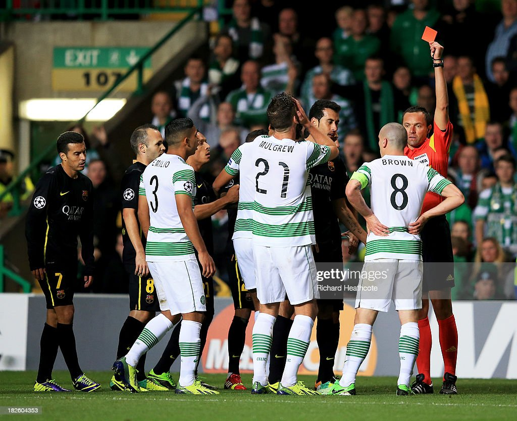 Scott Brown of Celtic (8) is shown a red card and is sent off by referee <a gi-track='captionPersonalityLinkClicked' href=/galleries/search?phrase=Stephane+Lannoy&family=editorial&specificpeople=2274380 ng-click='$event.stopPropagation()'>Stephane Lannoy</a> during the UEFA Champions League Group H match between Celtic and FC Barcelona at Celtic Park Stadium on October 1, 2013 in Glasgow, Scotland.