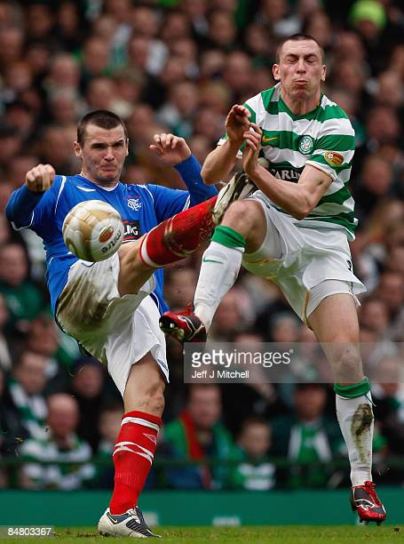 Scott Brown of Celtic is tackled by Lee McCulloch of Rangers during the Scottish Premier League match between Celtic and Rangers at Celtic Park on...