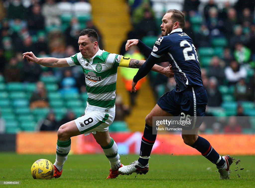 <a gi-track='captionPersonalityLinkClicked' href=/galleries/search?phrase=Scott+Brown+-+Soccer+Player+-+Celtic+F.C.&family=editorial&specificpeople=809203 ng-click='$event.stopPropagation()'>Scott Brown</a> of Celtic is tackled by Martin Woods of Ross County during the Ladbrokes Scottish Premiership match between Celtic and Ross County at Celtic Park Stadium on February 13, 2016 in Motherwell, Scotland.