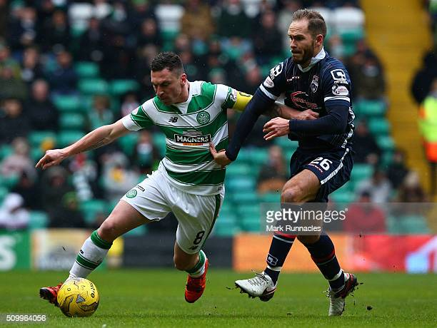 Scott Brown of Celtic is tackled by Martin Woods of Ross County during the Ladbrokes Scottish Premiership match between Celtic and Ross County at...