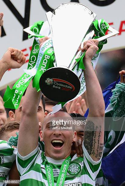 Scott Brown of Celtic lifts the Scottish Premier League trophy following the Clydesdale Bank Scottish Premier League match between Celtic and St...