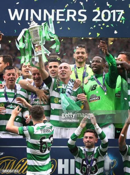 Scott Brown of Celtic lifts the trophy during the William Hill Scottish Cup Final between Celtic and Aberdeen at Hampden Park on May 27 2017 in...